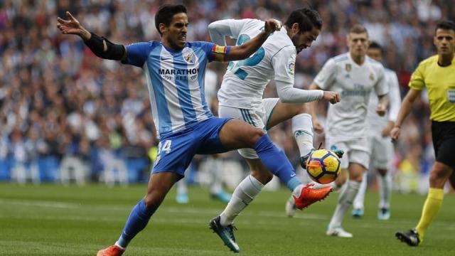 Ronaldo lập công từ chấm phạt đền, Real vất vả vượt qua Malaga